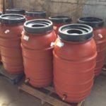 Turn an old olive barrel into a rain barrel.