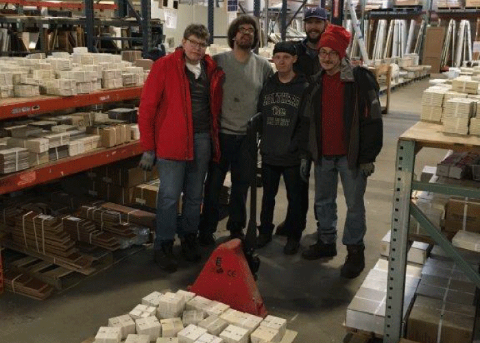 Goodwill  trainees stocking tile aisle, 2018.