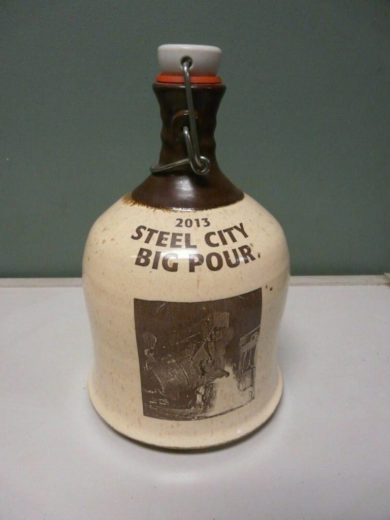 Steel City Big Pour commemorative swing top ceramic jug growler. Brown and tan glaze with 2013 Steel City Big Pour, Construction Junction logo and images.