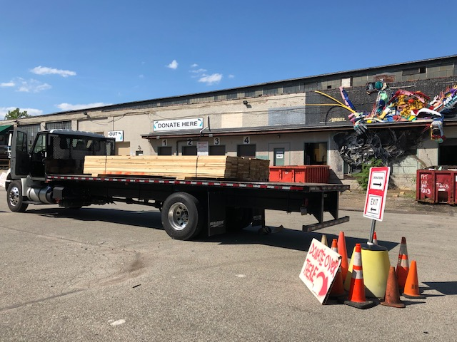 Lumber from a recent deconstruction job  sits on a flat bed truck in front of Construction Junction.