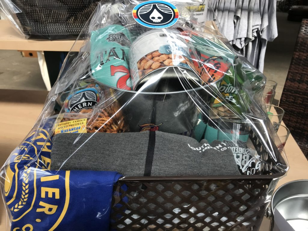 Fuhrer Wholesale Basket with assorted beers, snacks, and merch.